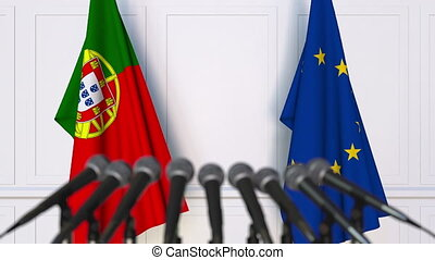 Flags of Portugal and the European Union at international meeting or negotiations press conference