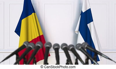 Flags of Romania and Finland at international meeting or...