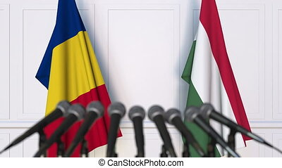 Flags of Romania and Hungary at international meeting or...