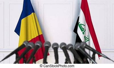 Flags of Romania and Iraq at international meeting or...
