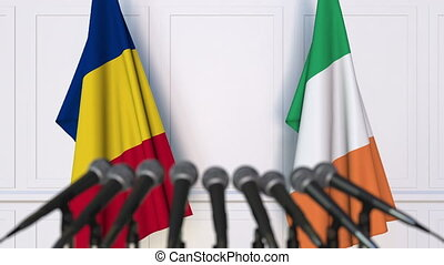 Flags of Romania and Ireland at international meeting or...