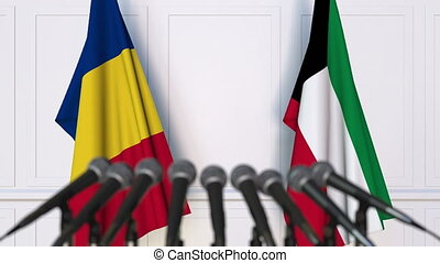 Flags of Romania and Kuwait at international meeting or...