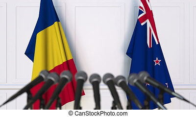 Flags of Romania and New Zealand at international meeting or...