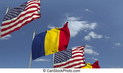 Flags of Romania and the USA at international meeting,...