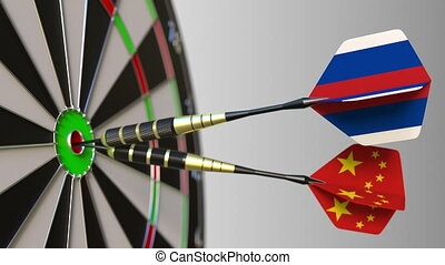 Flags of Russia and China on darts hitting bullseye of the target. International cooperation or competition animation