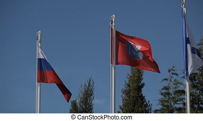 Flags of Russia and Crimea. Andreevsky flag in the sky
