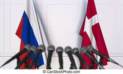 Flags of Russia and Denmark at international meeting or...