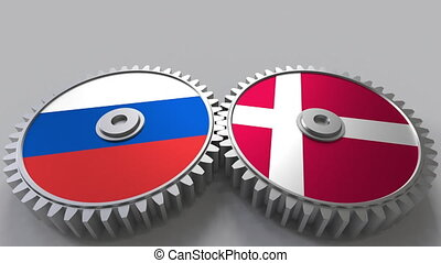 Flags of Russia and Denmark on meshing gears. International...