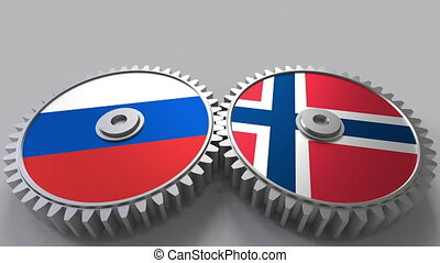 Flags of Russia and Norway on meshing gears. International...