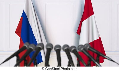 Flags of Russia and Peru at international meeting or...