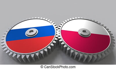 Flags of Russia and Poland on meshing gears. International...