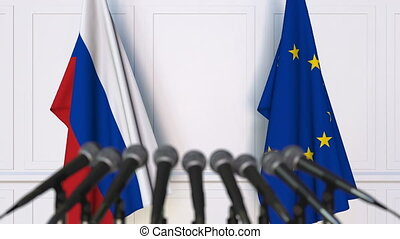 Flags of Russia and the European Union at international meeting or negotiations press conference