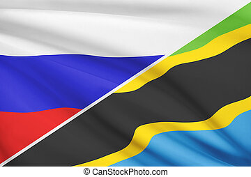 Flags of Russia and United Republic of Tanzania blowing in the wind. Part of a series.