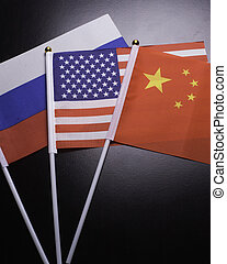 Flags of Russia, China, Iran and the USA show the relationship between the two countries .