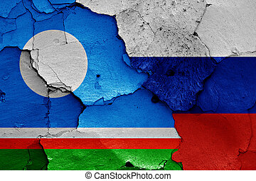 flags of Sakha and Russia painted on cracked wall