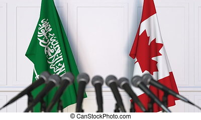 Flags of Saudi Arabia and Canada at international meeting or...