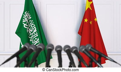Flags of Saudi Arabia and China at international meeting or...