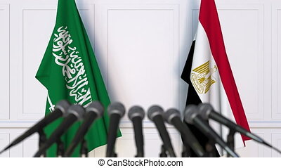 Flags of Saudi Arabia and Egypt at international meeting or...