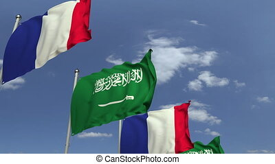 Flags of Saudi Arabia and France at international meeting,...