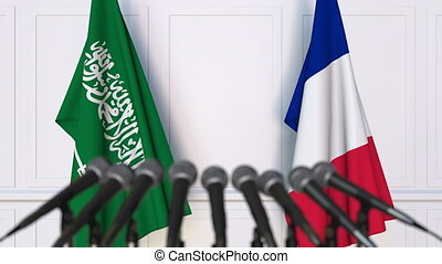 Flags of Saudi Arabia and France at international meeting or...