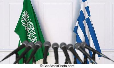 Flags of Saudi Arabia and Greece at international meeting or...