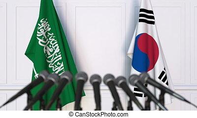 Flags of Saudi Arabia and Korea at international meeting or...