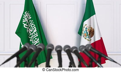 Flags of Saudi Arabia and Mexico at international meeting or...