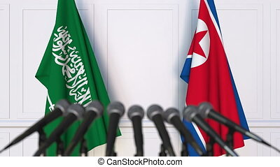 Flags of Saudi Arabia and North Korea at international...