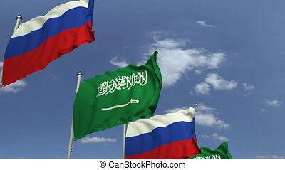 Flags of Saudi Arabia and Russia at international meeting,...