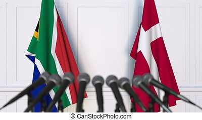 Flags of South Africa and Denmark at international meeting...