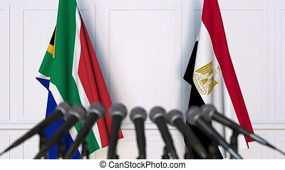 Flags of South Africa and Egypt at international meeting or...
