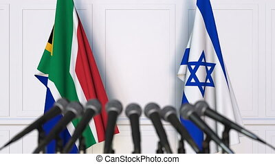 Flags of South Africa and Israel at international meeting or...