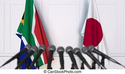Flags of South Africa and Japan at international meeting or...