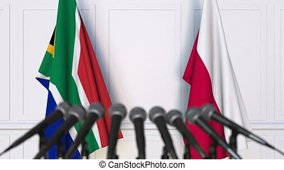 Flags of South Africa and Poland at international meeting or...