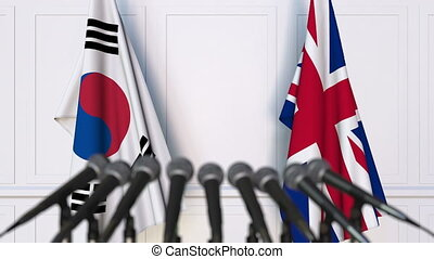Flags of South Korea and The United Kingdom at international...