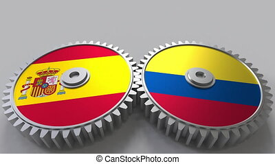 Flags of Spain and Colombia on meshing gears. International...