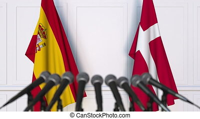 Flags of Spain and Denmark at international meeting or...