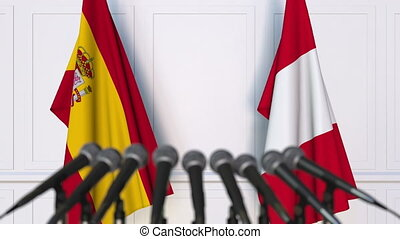 Flags of Spain and Peru at international meeting or...