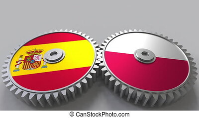 Flags of Spain and Poland on meshing gears. International...