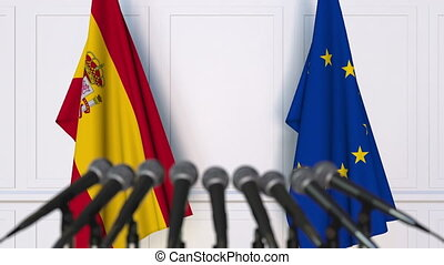 Flags of Spain and the European Union at international meeting or negotiations press conference