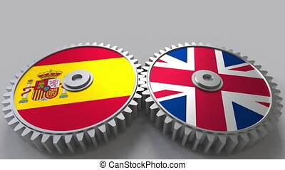 Flags of Spain and the United Kingdom on meshing gears....
