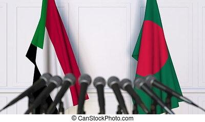 Flags of Sudan and Bangladesh at international meeting or...