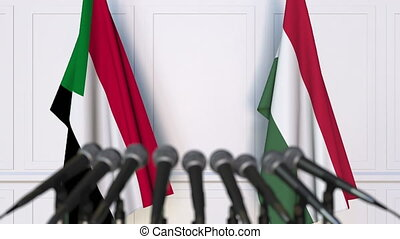 Flags of Sudan and Hungary at international meeting or...
