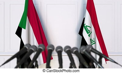 Flags of Sudan and Iraq at international meeting or...
