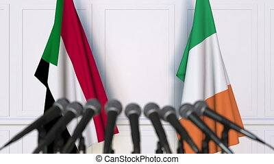 Flags of Sudan and Ireland at international meeting or...