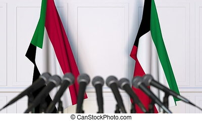 Flags of Sudan and Kuwait at international meeting or...