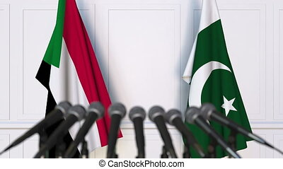 Flags of Sudan and Pakistan at international meeting or...