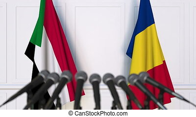 Flags of Sudan and Romania at international meeting or...