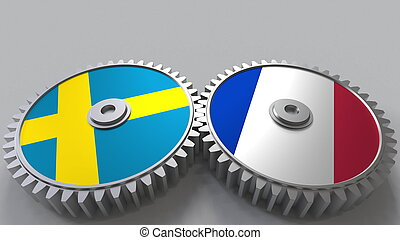 Flags of Sweden and France on meshing gears. International cooperation conceptual 3D rendering