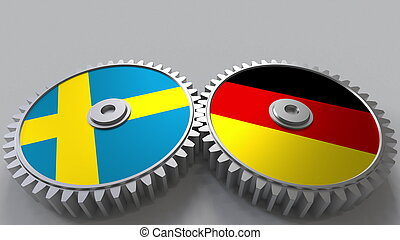 Flags of Sweden and Germany on meshing gears. International cooperation conceptual 3D rendering